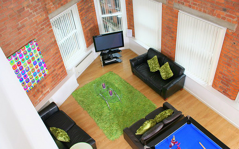Birds eye view of two sofas set alongside a blue pool table, flat screen TV