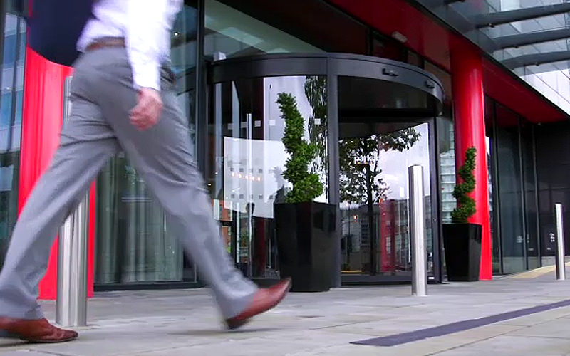 A man walking past the entrance of the Park Inn Radisoon, Manchester