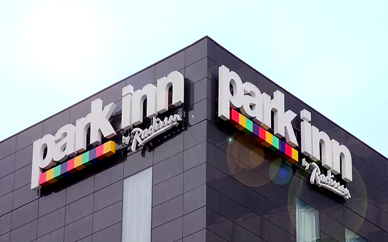 The logo of the Park Inn Radisson, Manchester, during the day