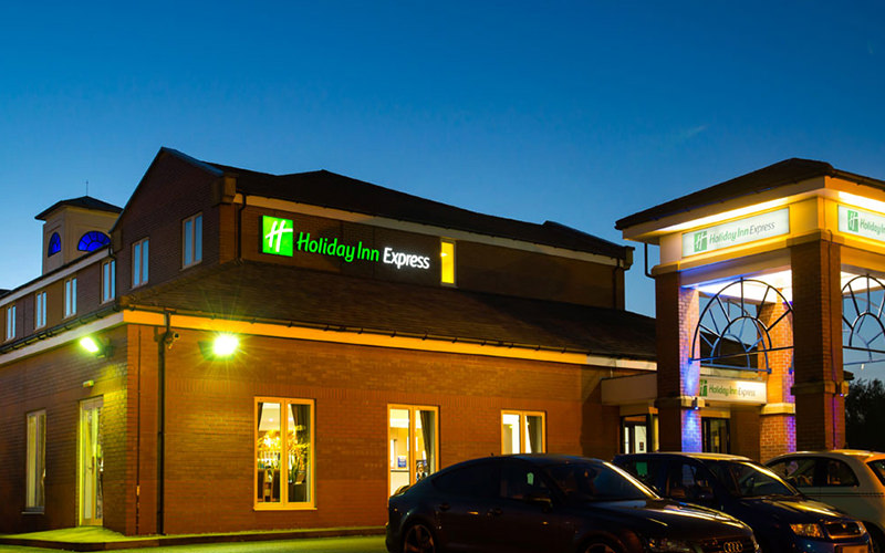 The exterior of the Holiday Inn Express, Manchester, at night