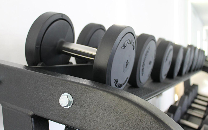 Weights stacked on shelves