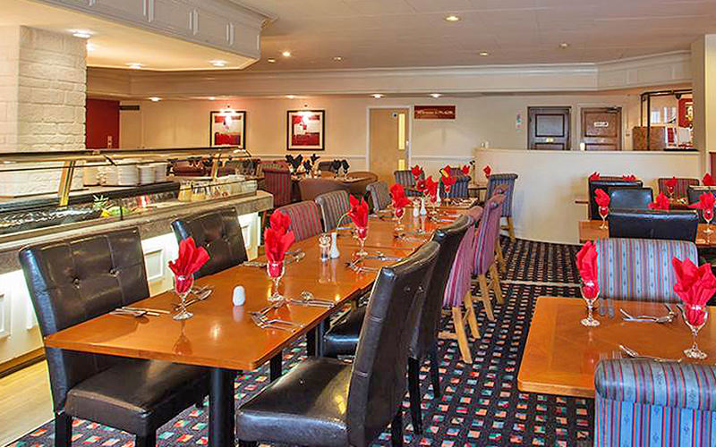 Long tables and chairs in the Britannia Leeds hotel restaurant