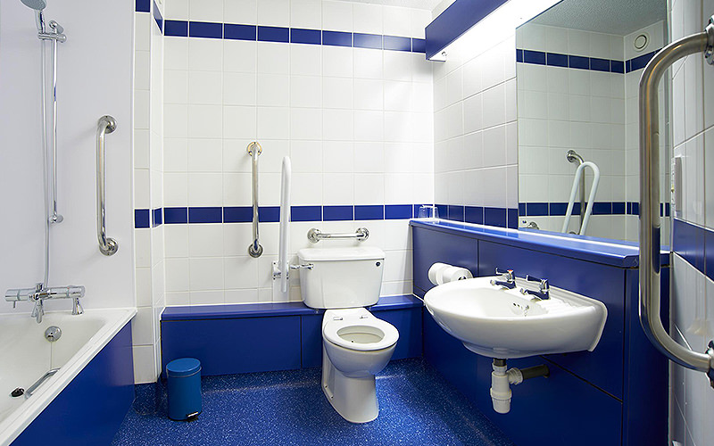 A blue and white bathroom in Travelodge Christchurch
