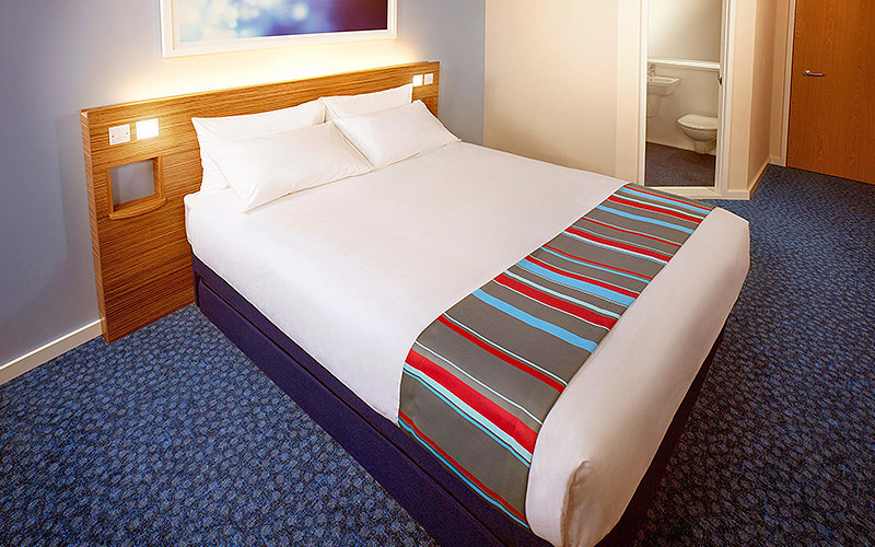 A double bed in Travelodge Christchurch