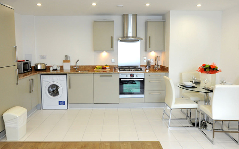 A kitchen and dining table set for four in an apartment