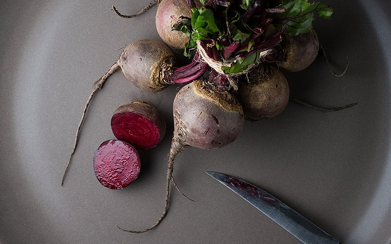 Raw beetroot in a black pan