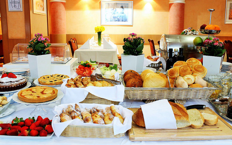 Continental breakfast spread at the Hotel Rex in Belgrade, with pastries and bread on a table