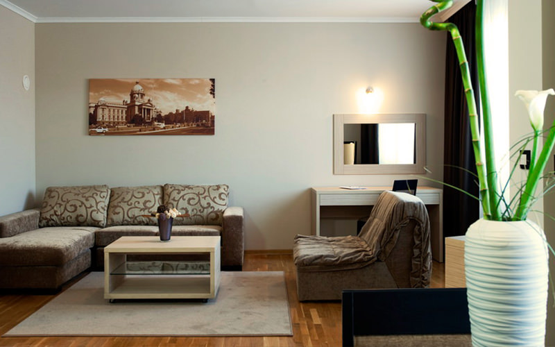 A living room area with brown and cream decor