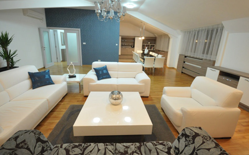 White sofas in square layout, with a white coffee table