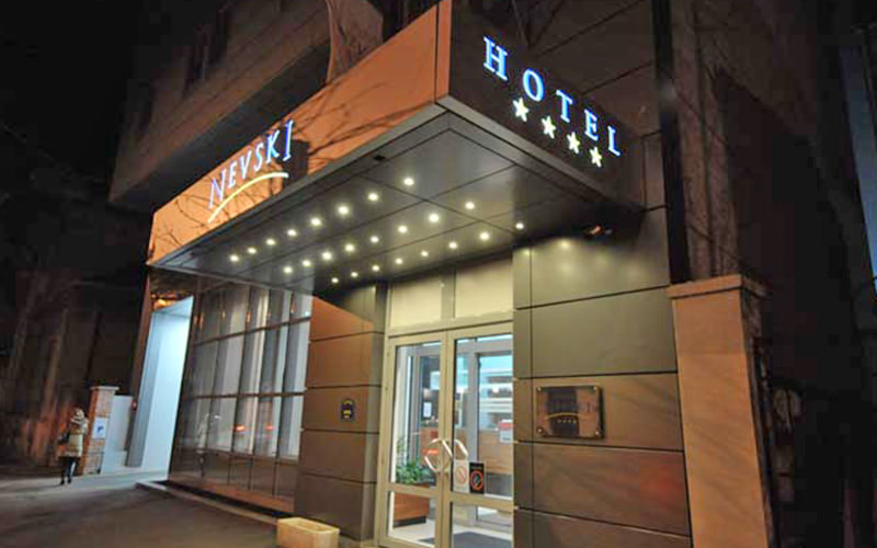 The exterior of the Nevski Hotel at night