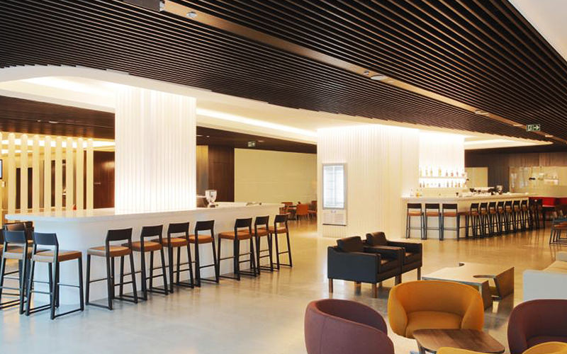 A contemporary dining room style bar