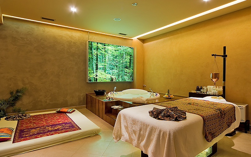 A massage room with luxurious treatment areas