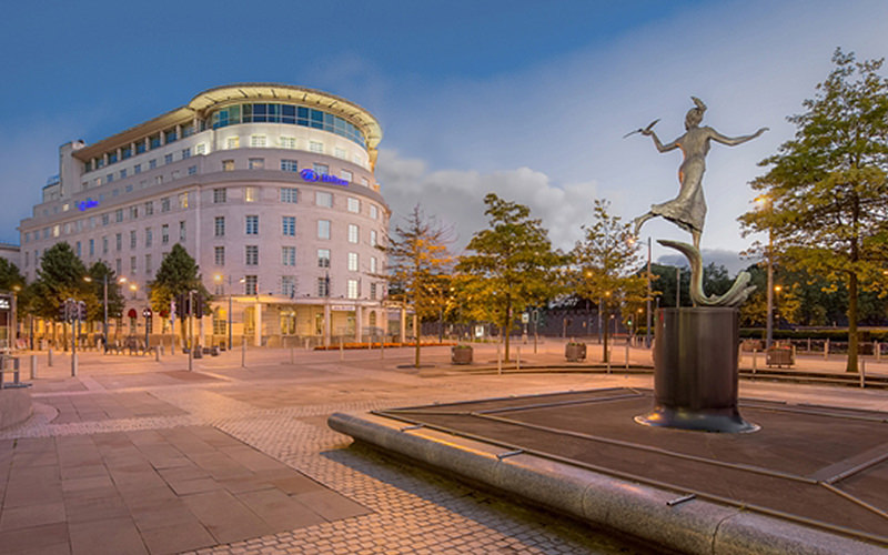 Exterior of Hilton Cardiff with a statue outside