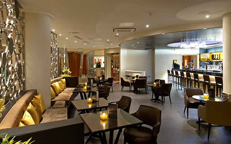 Bar area of Hilton Cardiff with comfortable brown seating