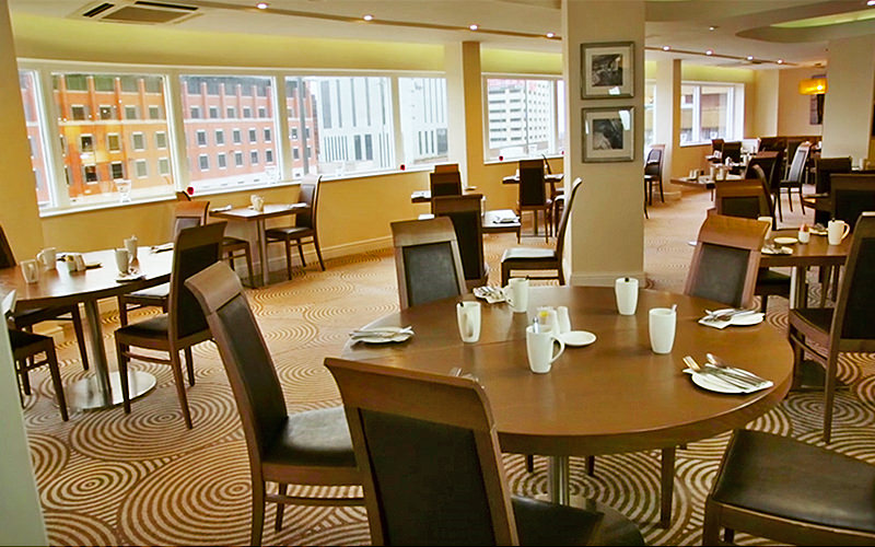Tables and chairs in the restaurant at the Mercure Liverpool Atlantic Tower Hotel