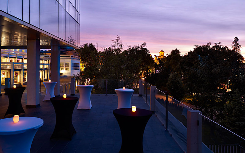 Outdoor hotel terrace with lights on tables