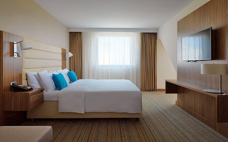 A spacious, modern double room with large window in Courtyard by Marriott in Belgrade