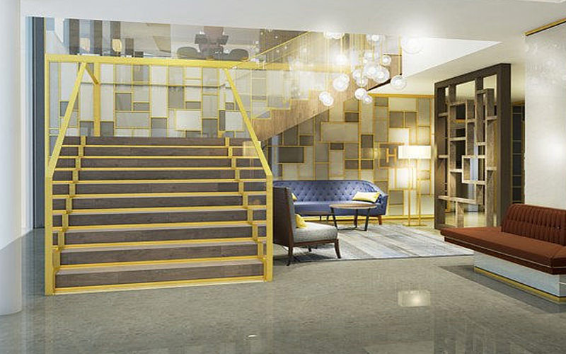 The reception area and staircase with hanging lights in the Courtyard by Marriott hotel