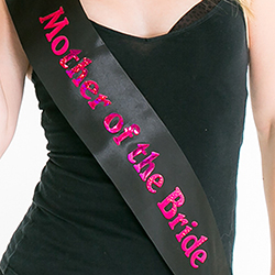 A girl wearing the sash with a black vest top
