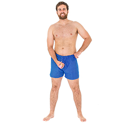 A model wearing the shorts and holding the feature