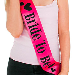 Bright pink sash with black writing