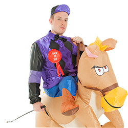 Whipping his inflatable horse