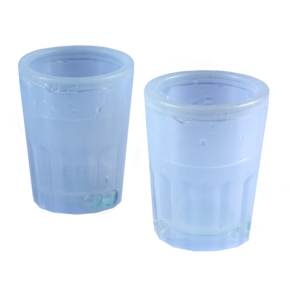 Glow in The Dark Shot Glasses On White Background