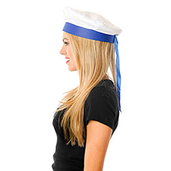 Woman in Sailor Hat In White With Blue Ribbon