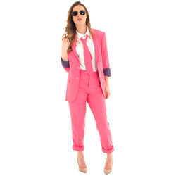 The model wears the suit along with sunglasses