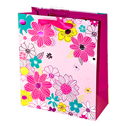 A pink flower gift bag with ribbon handle