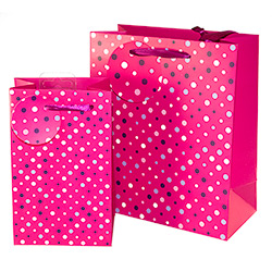 The pink spotted bag comes in two sizes