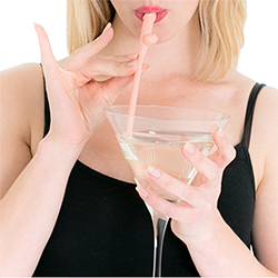 Using a straw to drink from this massive Martini glass