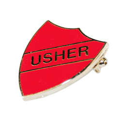 Side view of the red usher shield badge