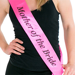 The hot pink sash looks great against a black background