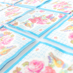 Small vintage-style floral napkins with blue border