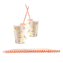 Vintage-style pink floral paper straws in floral paper cups