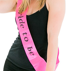 The hot pink sash looks great with a black vest top
