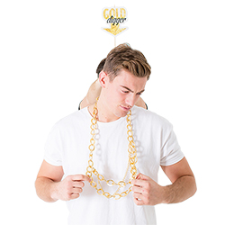 Male model wearing necklace with 'Gold Digger' prop behind him