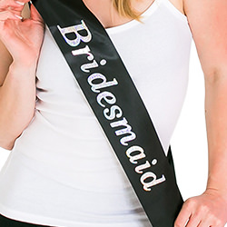 The model looking at the camera while wearing the sash