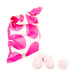 Pink polka dot favour bag with bonbons
