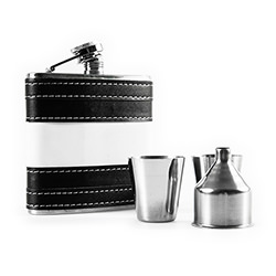 The flask with the shot glasses standing in front of it.