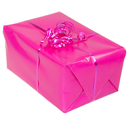 Hot pink wrapping paper covering a gift with a pink ribbon