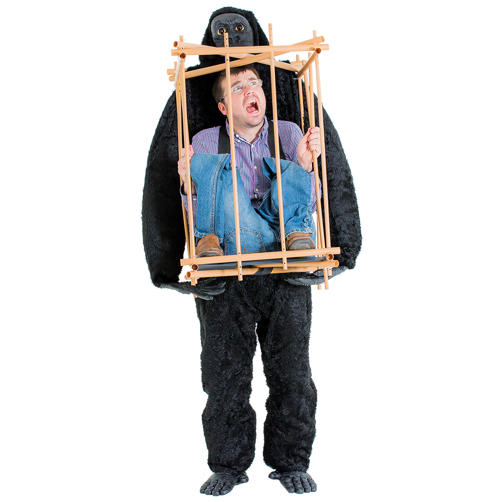 Man wearing the man in a cage with gorilla costume, looking frightened