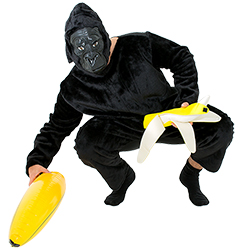 A male model crouching down in the King Dong costume whilst holding an inflatable banana