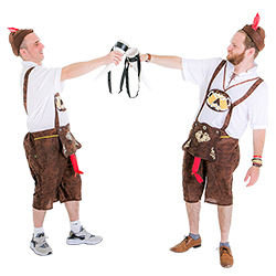 Two Bavarian gents clinking their horns