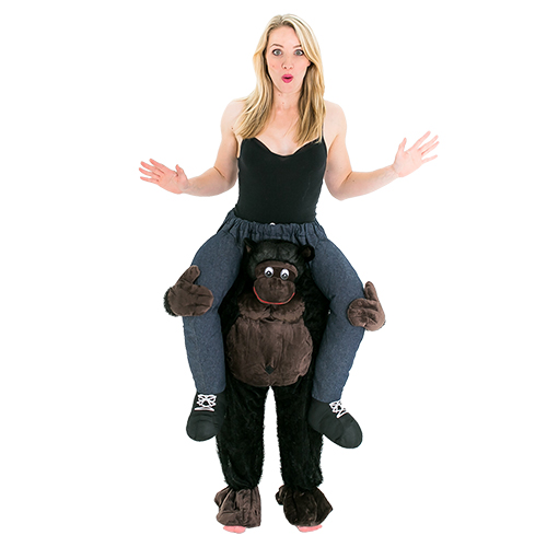Woman wearing hen party costume that makes her look like she's being carried by a gorilla