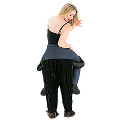 Woman wearing hen party costume that makes her look like she's being carried by a gorilla - back view