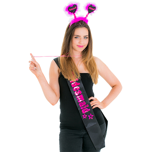 Model holding the whistle from the Black and Pink Bridesmaid Set