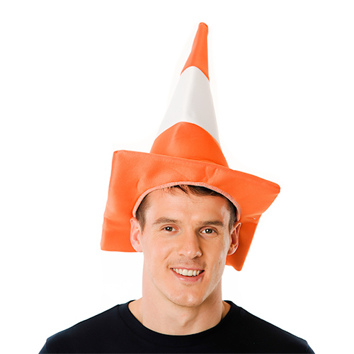 Man wearing a traffic cone hat