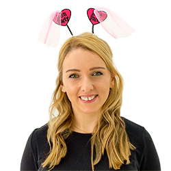 A girl wearing hen party head boppers with pink veils attached
